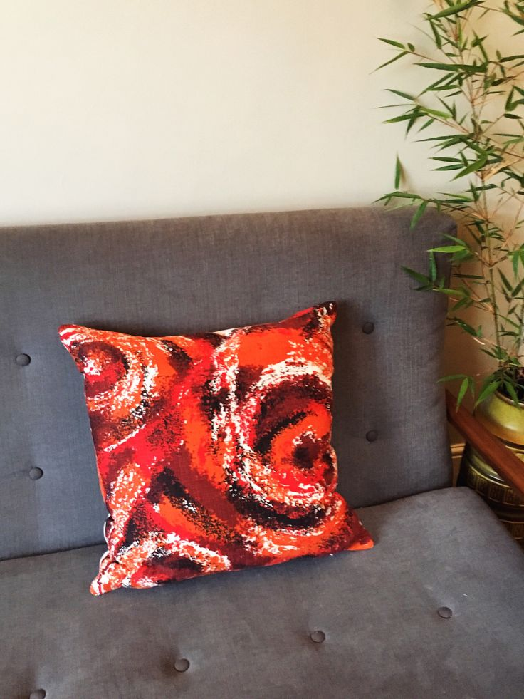 Red swirling abstract print in 50s/60s vintage barkcloth made into a cushion cover - ideal to complement mid century decor! printhttps://www.etsy.com/uk/listing/546419637/cushion-cover-in-vintage-cotton #barkcloth #redcushion #vintagecushion #swirlingfabric #abstractcushion