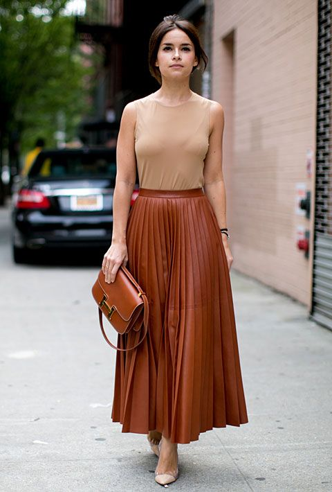 Very classy. . Brown pleated skirt & taupe sleeveless top with brown bag.