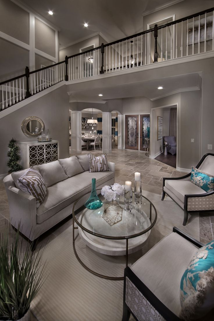 Modern elegant living room has a sofa that is big and beautiful and - How Would You Describe This Space