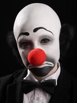 clown with red tennis ball for nose
