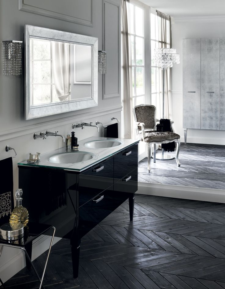 Seductive black. Slate Black glossy lacquer and Chrome-finish profiles, #Swarovski™ Crystal Black handles and chrome-finish metal feet is highly dramatic. The Flow washbasin, the surface (in Nero Marquinia marble), the lamps and mirror are all in the same shade.