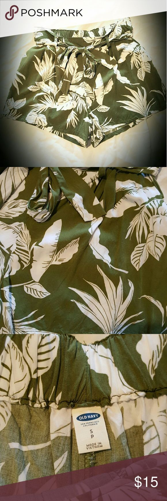 High Rise Tropical Summer Shorts Olive green and white with a tropical vibe! Flowy, light and comfortable, and they have pockets! The waist has elastic across the whole back for a good fit, and there is also the belt that ties in front. The belt is stitched onto to the shorts on the back, so it is not removeable, unless you wanted to take the stitching out. Super cute, worn once. Length is 13 inches from waist to hem. Inseam is 3 inches. Size is small petite but would also fit a medium. 100%…