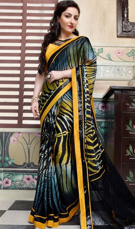 Give a simple yet stylish look as soha ali khan dressed in this multicolor crepe and net sari. The enticing lace, printed and sequins work all through the attire is awe-inspiring.  #jacquardsilksaree #bollywooddesignsari #netsarionline