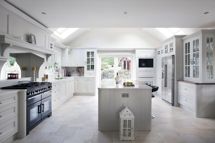 """This grey painted kitchen is a design by Woodale Designs. It has been hand crafted using solid wood and countertops of Silestone """"Bianca River""""."""