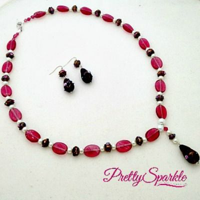 Made with pink oval glass beads, black Wedding Cake glass beads and glass pearls.. Set retails at $35. Please email me at prettysparklejewels@gmail.com if interested.