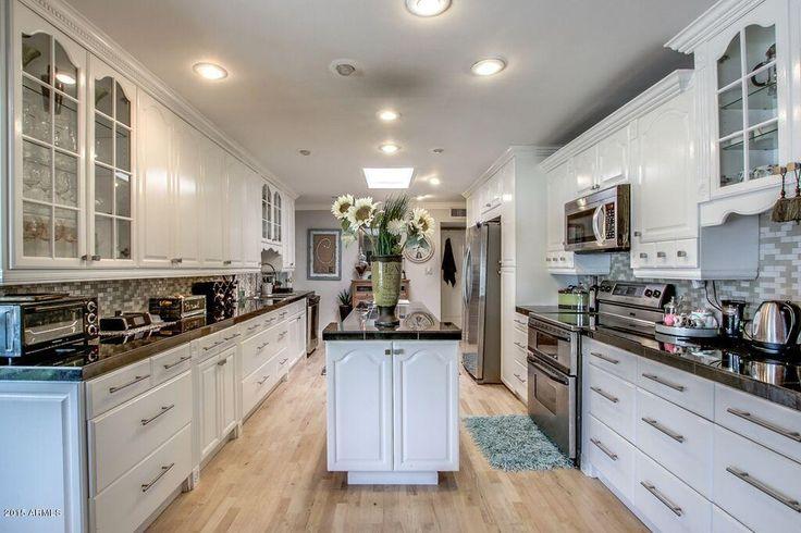 Traditional Kitchen with Raised panel, Galaxy Black, Granite, Kitchen island, Hardwood floors, Crown molding, U-shaped, Flush