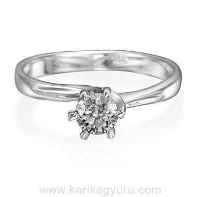 Karikagyűrű Áruház Klasszikus egy köves eljegyzési gyűrű, 18K fehér aranyból, igény szerint 0,30ct-0,60ct súlyú briliánssal. A foglalat kb. 2,30gr súlyú. www.karikagyuru.com