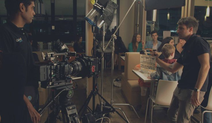 The film crew at work on set during the production of a television commercial.