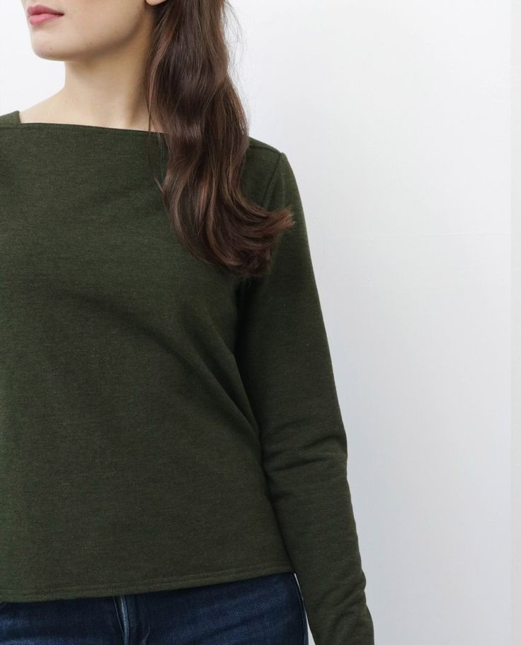 SO MANY WAYS TO WEAR IT, YOU'LL WONDER HOW YOU EVER LIVED WITHOUT IT. It's not cropped it's just not that long (in the front). This is not your average sweatshirt, it's elevated in style but holds true with the comfort. We fashioned this boatneck sweatshirt with shoulder panels to keep it laying nice on your shoulders, it's a little higher in the front and scooped low in the back. Think; perfect length for high-rise bottoms or for a nice layer to wear over your dresses.
