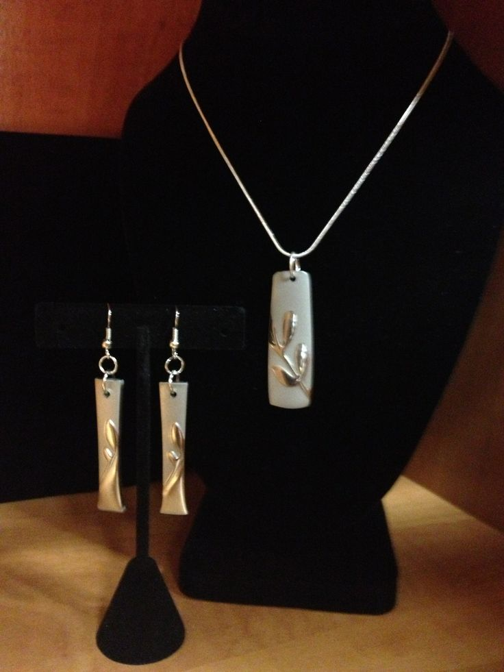 Leaf pattern spoon handle pendant on a sterling silver chain with drop earrings to match.