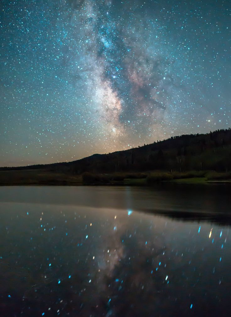 "They don't call it ""Star Valley"" for nothing. Milky way reflecting on a calm lake near Afton Wyoming [OC][3490x4779] http://ift.tt/2wpW6Gy"