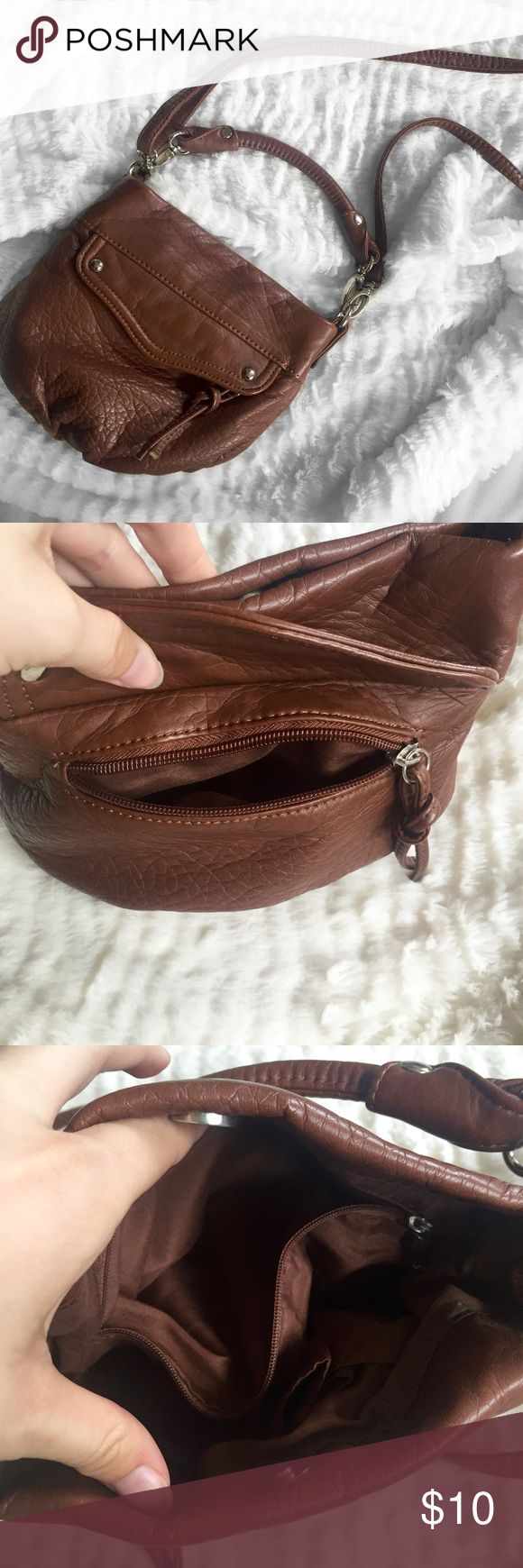 """Vegan / Faux Brown Leather Crossbody Bag Candie's Brand • Faux / vegan leather • Has a flap on the front with a zipper pocket underneath • 2 card pouches inside as well as a zipper pocket • In perfect condition • Detachable handle with adjustable crossbody strap • 8.5"""" x 7"""" x approx. 3"""" Bags Crossbody Bags"""