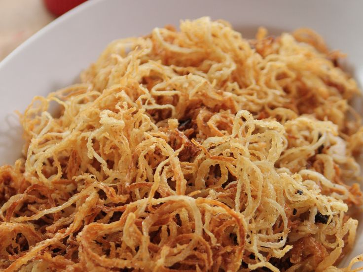 Get this all-star, easy-to-follow Beer-Battered Onion Strings recipe from Ree Drummond