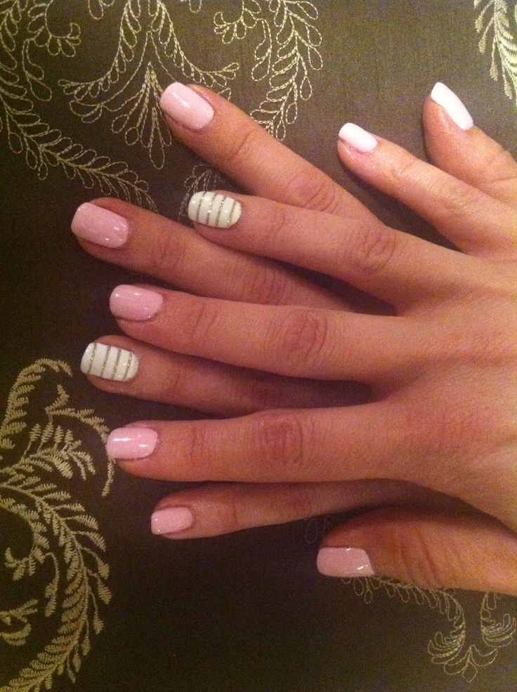 Pink smoothie gel nails with white accent nail with gold glitter stripes