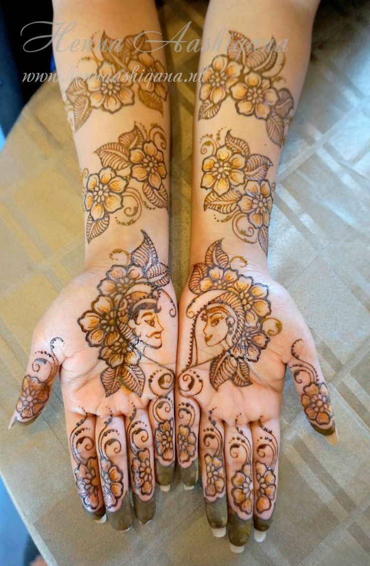 Bridal Mehndi 2013 - Dulha and dulhen bridal mehndi design with lost of flowers negative space and dipped fingertips