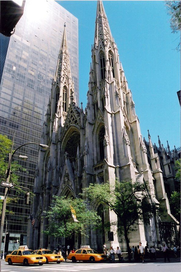 St. Patrick's Cathedral, Manhattan, New York City.   The Neo-Gothic-style cathedral, which can accommodate 2,200 people, is built of brick clad in marble, quarried in Massachusetts and New York. It takes up a whole city block.  The cathedral was completed in 1878, its huge proportions dominating the midtown of that time.  Outstanding features include its stained glass, altar and art works, and three organs.  by Alan Knox
