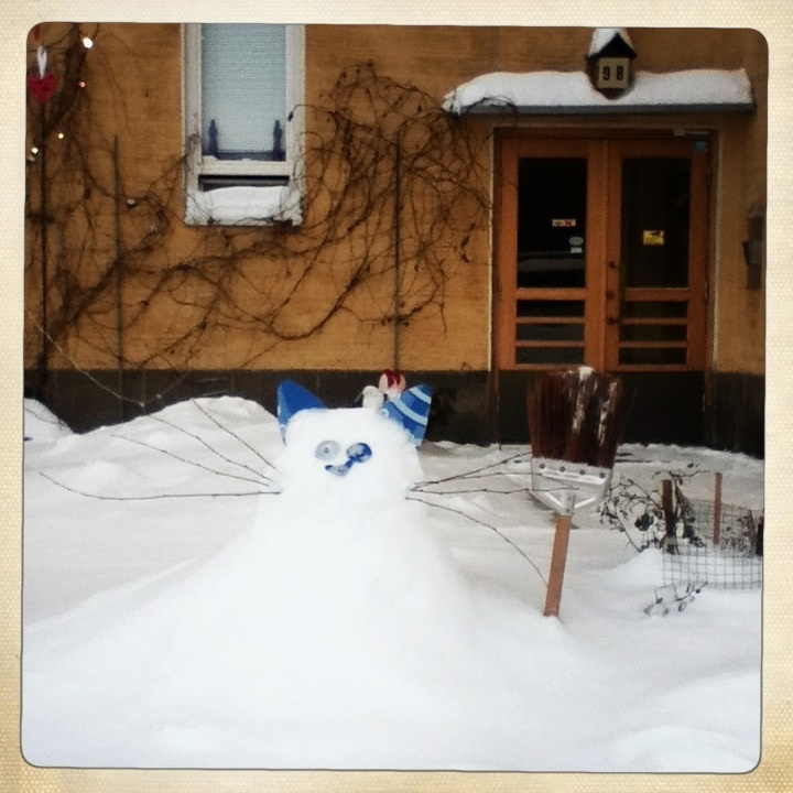Snow cat in front of a house. Alppila, December.