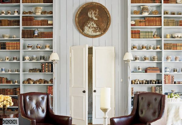 A giant penny adorns one wall of the library in Oprah's Santa Barbara guest house