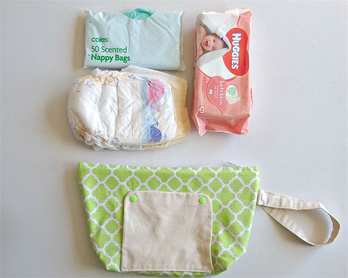 lime, green and white quatrefoil nappy wallet now available in store