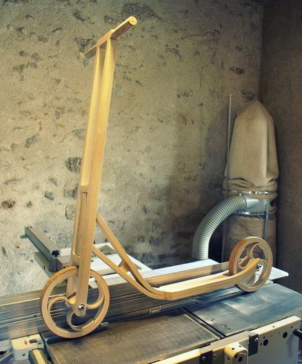 Wooden scooter. I want one of these :)