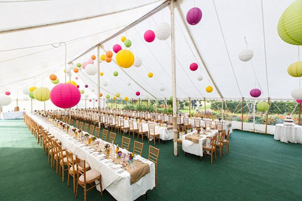 Hanging lanterns for a bright and colourful Somerset marquee wedding. Photography by www.photoglow.co.uk