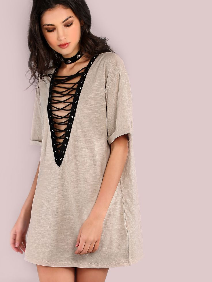 """You'll be looking cool as can be with this top. Featuring an oversized shirt dress with rolled short sleeves, a plunging v-neckline with contrasting lace up detailing and the perfect neutral hue. Dress measures 29.8"""" in. from top to bottom hem. Kill it with black denim shorts, ankle booties and hoop earrings. #90s #grunge #MakeMeChic #style #fashion #newarrivals #fall16"""