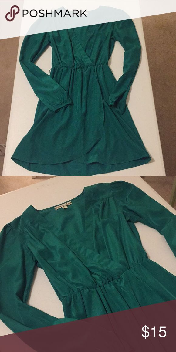 "Emerald Satin Long Sleeve Dress Beautiful silky emerald green dress with plunging v-neck, tulip hem skirt, puckered shoulder long sleeves, and gathered elastic waist. This looks so elegant on. Worn once, no flaws. There are threads on the side to hold a belt, which was missing when purchased. Measures 31.5"" in length from shoulder to hem, 17"" across chest from armpits, and about 17"" across hips laying flat. The waist is elastic and measures about 18"" fully stretched out. Accidentally In Love…"