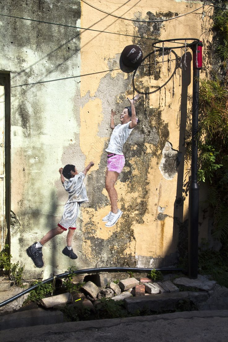 By Ernest Zacharevic. In George Town, Penang, Malaysia. http://restreet.altervista.org/ernest-zacharevic-street-artist-che-unisce-reale-e-irreale/