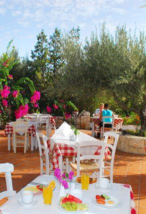 Porto Village Hotel in Hersonissos, Heraklion, Crete. This hotel is located in one of the most popular destination for holidays in Crete, close to shops and tavernas, away 500m from the sandy beach.