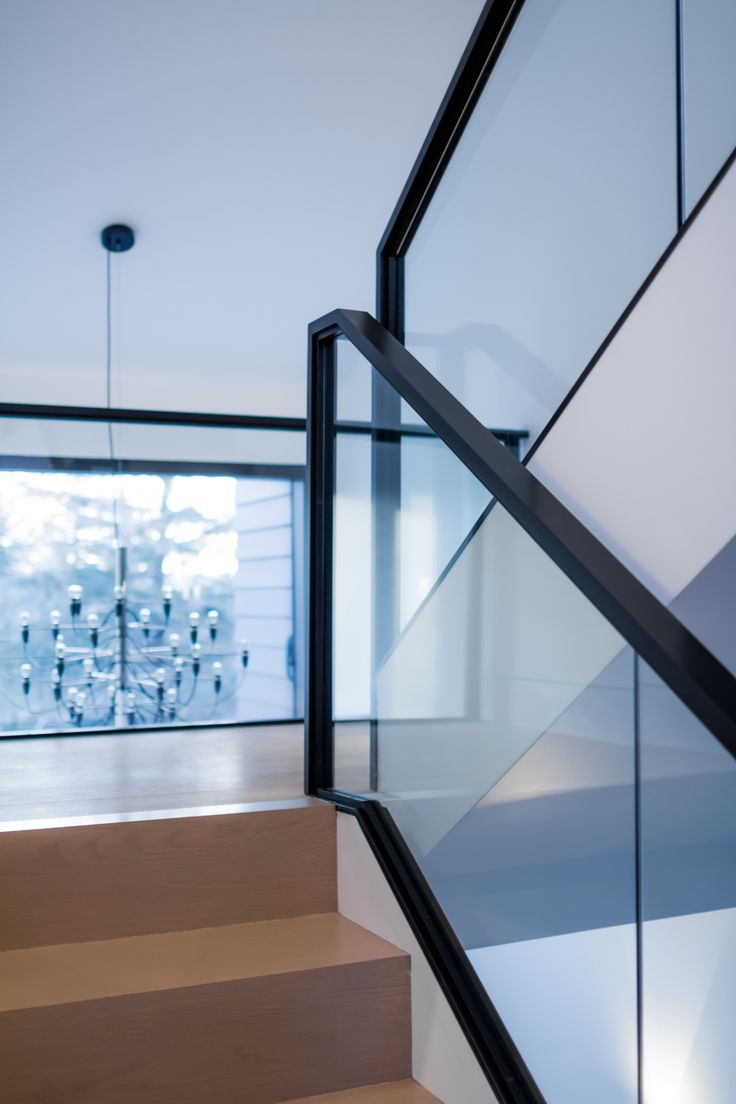 Modern Staircase With 90 Degree Square Edge Steps Black Metal And Glass Railings