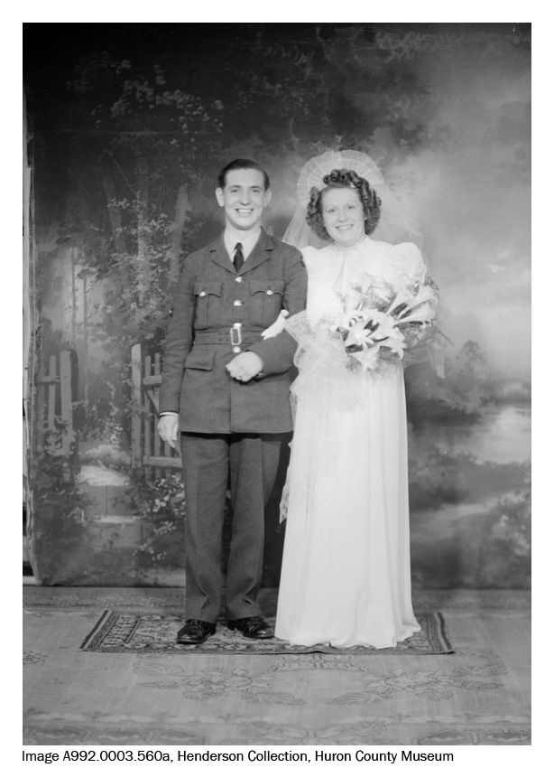 Along with portraits and air training images, we also have wartime wedding photos in the Henderson Collection, such as this one of Mr. and Mrs. J. Wilson. Because this image was scanned from a negative, it shows more in the frame than the final cropped prints, such as the edge of the backdrop visible on the left hand side.