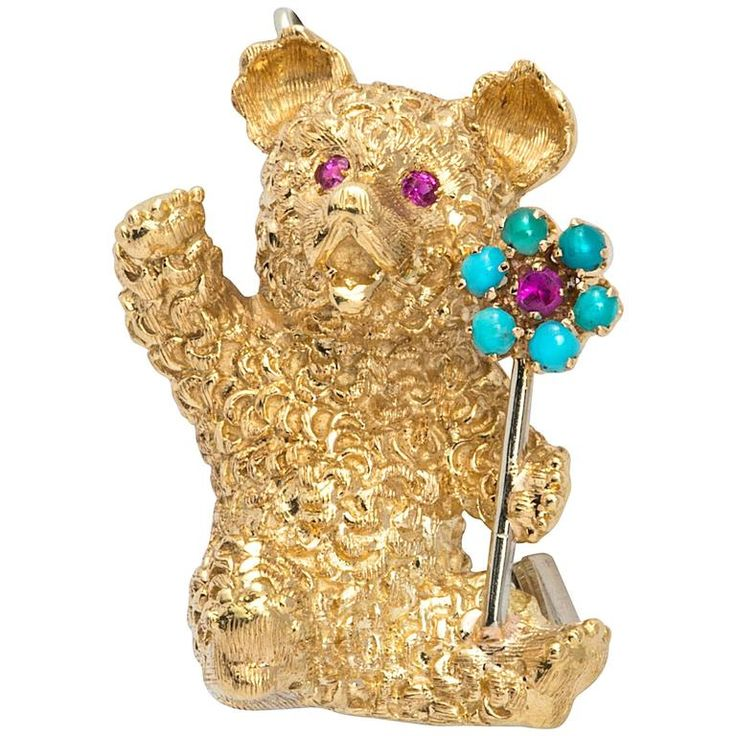 Cartier Gold Bear with Flower Brooch | From a unique collection of vintage brooches at https://www.1stdibs.com/jewelry/brooches/brooches/
