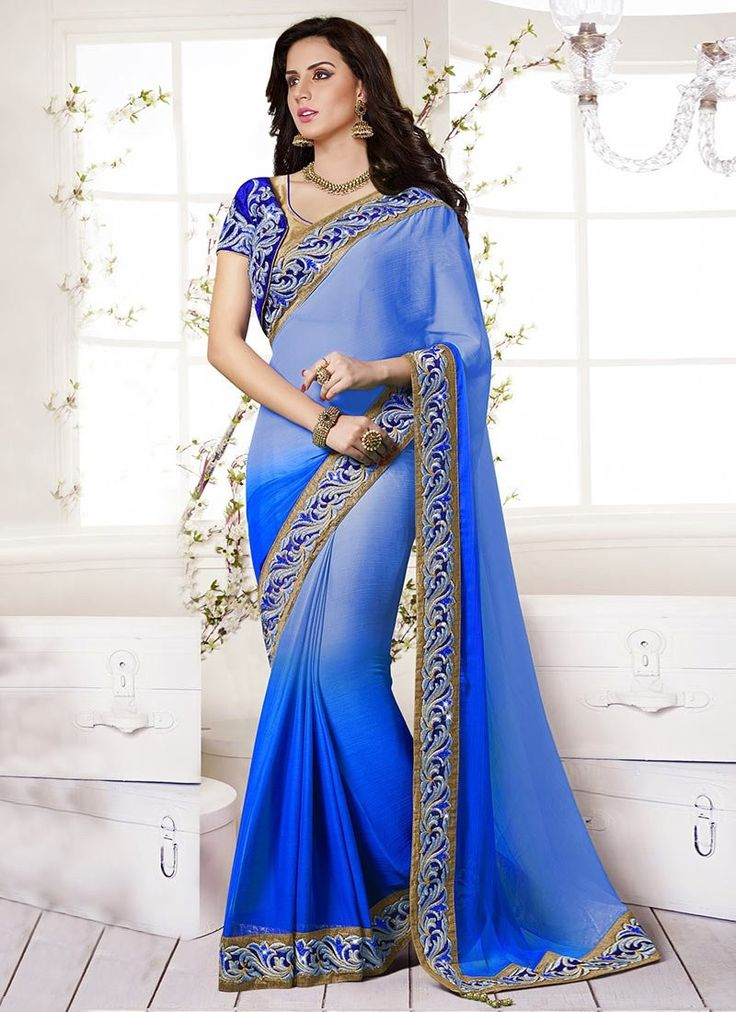Become the grandstand beauty clad in this fab blue faux chiffon party wear saree, it's embellish with patch border work, resham work, stone work and zari work. Comes with matching blouse fabric....