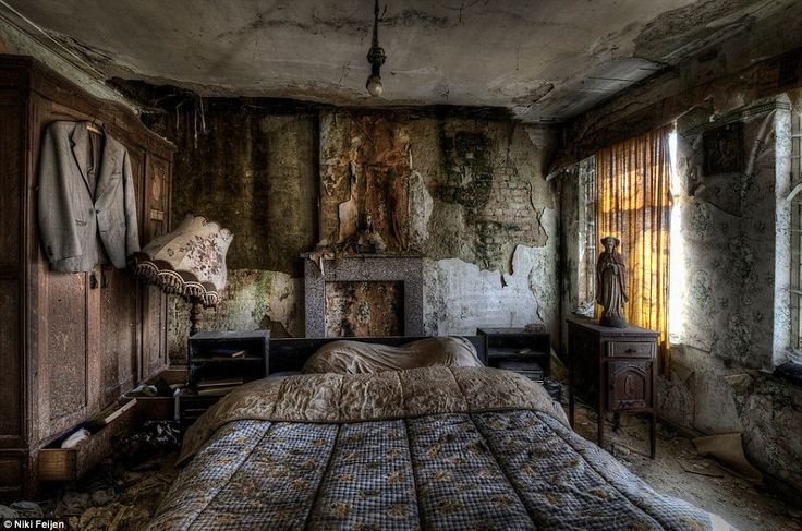 Empty: The bed is still covered by a neatly folded duvet in this abandoned farmhouse - but its unlikely anybody would want to sleep in it