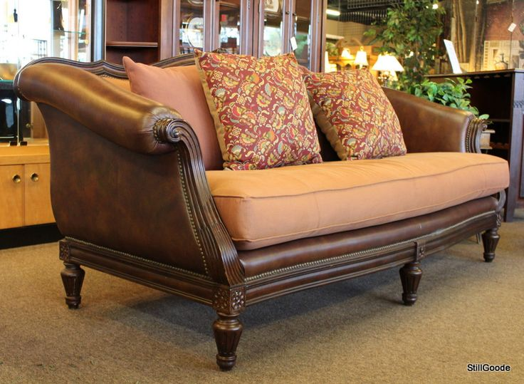 Thomasville sofa with leather sides and back, upholstered seat, 5 throw pillows. #OnTheShowroomFloor #Thomasville #Sofa #Leather #Upholstered #StillGoode
