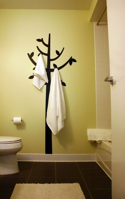 paint a tree and add hooks. so cute!