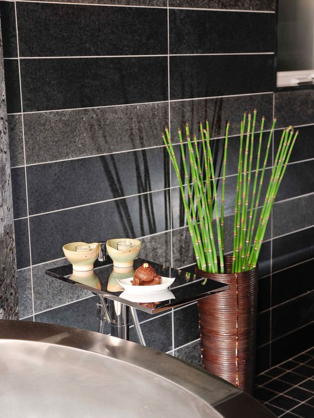 Tranquil elements like bamboo and tealight candles give this Asian modern bathroom a serene, spa-like feel.