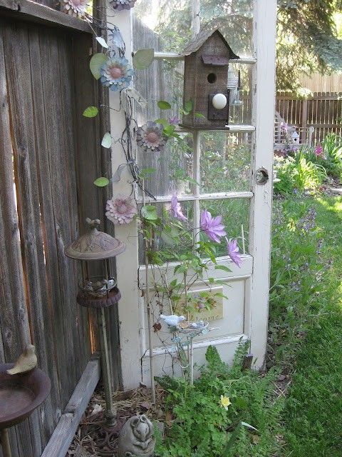 This is a great idea to fix up an old door and turn it into a flower garden display.