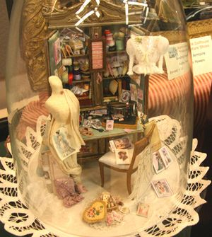 Vintage sewing room vignette in dolls house scale with an overflowing armoire. - Photo Copyright 2011 Lesley Shepherd