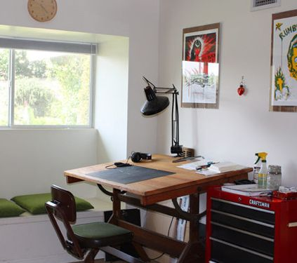 Old drafting table for a desk and a craftsman tool chest for storage - great repurposed office!