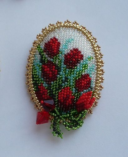 LOVE this beaded brooch. I used to make pins using the technique of bead embroidery on needlepoint canvas. Might have to start using that technique again. #TheCreativeCottage
