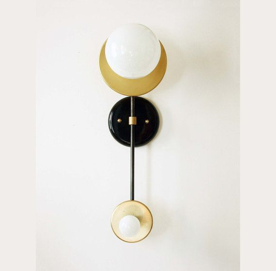 This Mid century double sconce lamp is a unique design piece handmade and handcrafted in our studio with sustainable materials. An elegant addition