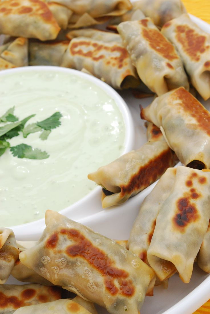 Southwestern Egg Rolls with Avocado Ranch Dipping Sauce - I'm going to try this with rice paper wrappers since they crisp well in the oven