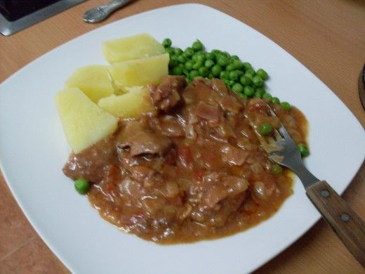 liver and bacon casserole served with boiled potatoes and peas