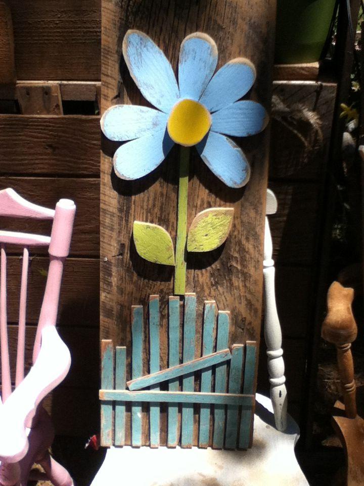 3 foot wooden flower on primitive weathered barnboard.......
