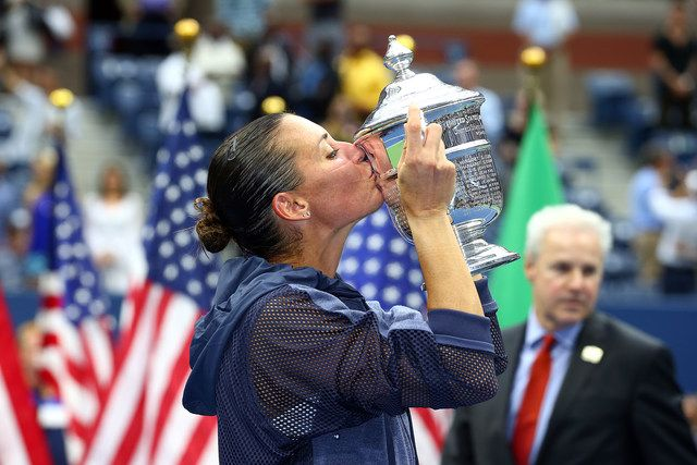 Flavia Pennetta kisses the women's singles trophy after defeating Roberta Vinci at the 2015 US Open.