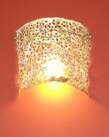 Handmade wall lamp made of brass.