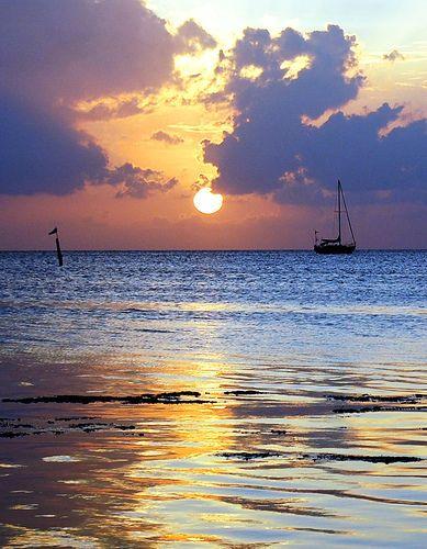 Caye Caulker, Belize at sunset. Let's Go!