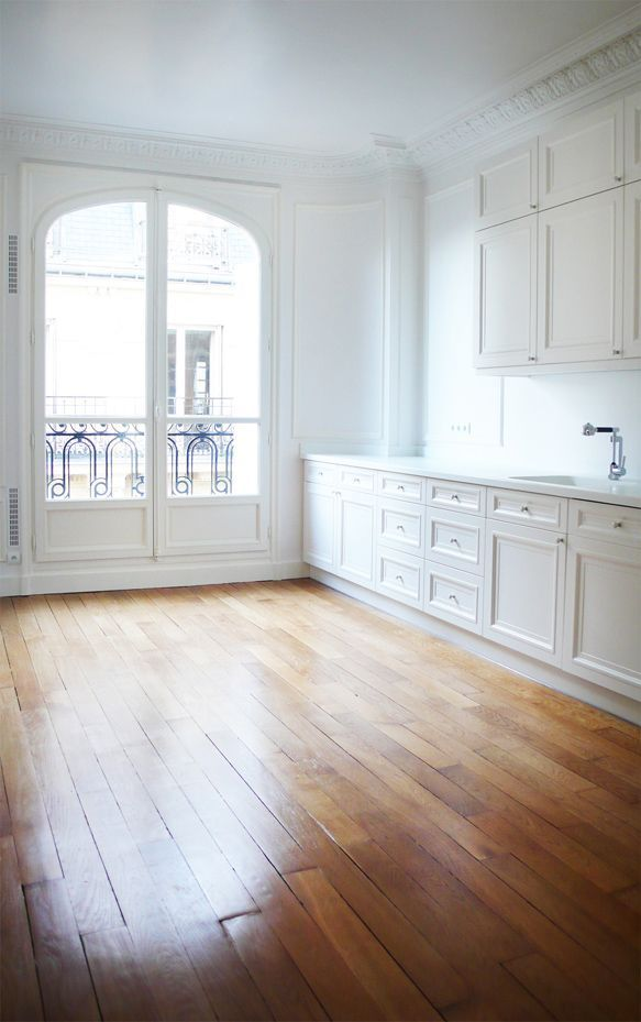 Gorgeous apartment in Paris with white cabinets, w…