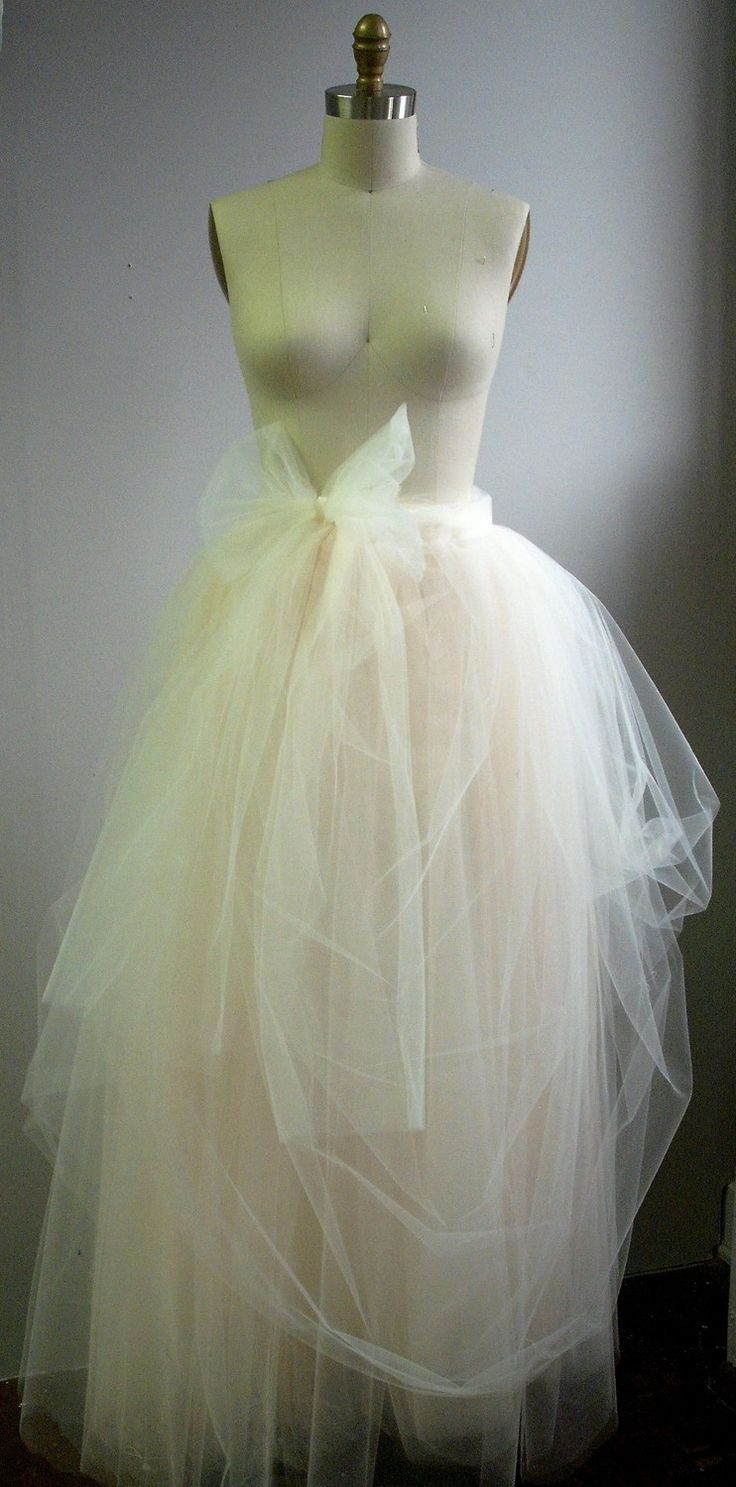 I love the color and texture of this for my wedding dress skirt. Tulle Bridal Skirt with Bow. $250.00, via Etsy.